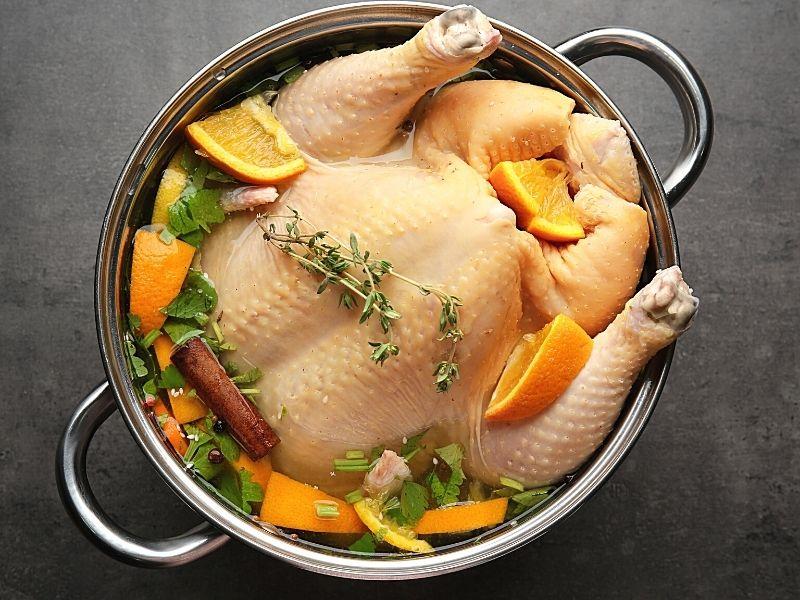 a turkey brining in a pot.