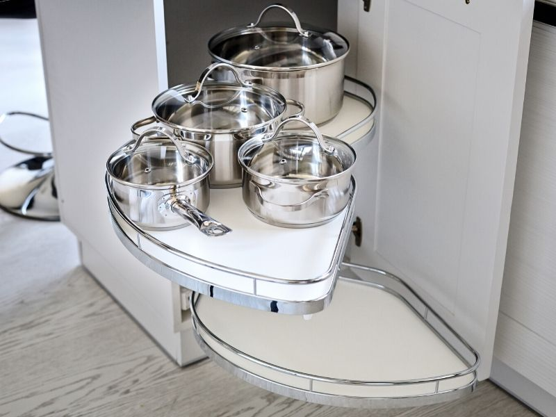 pots and pans in a cabinet