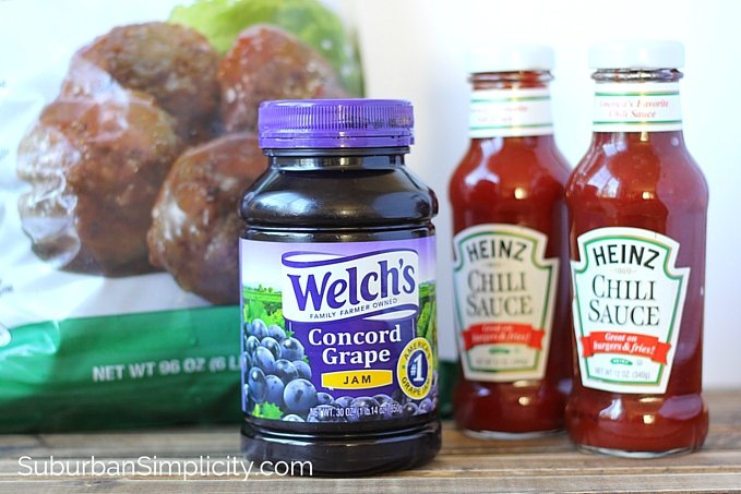 The ingredients for crockpot meatballs on a counter top - Meatballs, grape jelly and chili sauce.