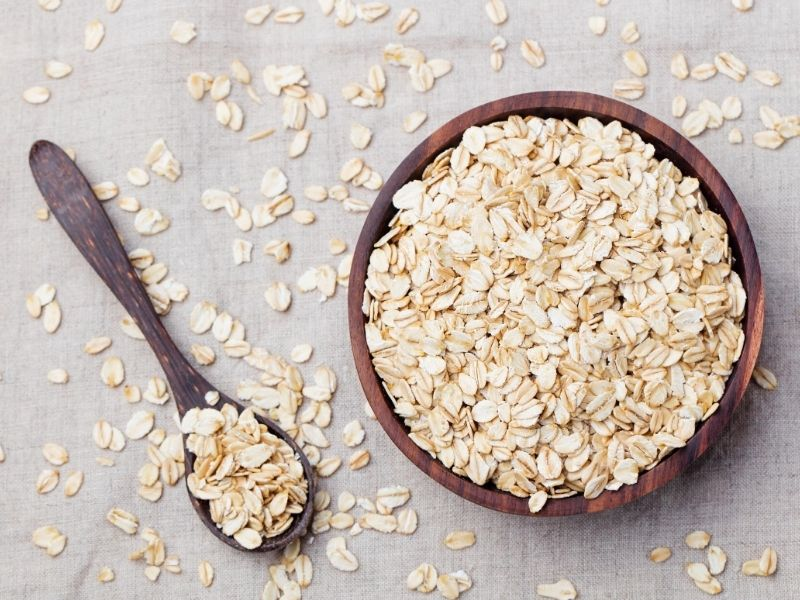 Uncooked oatmeal in a bowl.