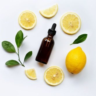 Lemon essential oil in a glass container