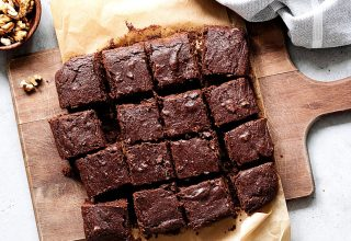 Dark chocolate brownies on a cutting board