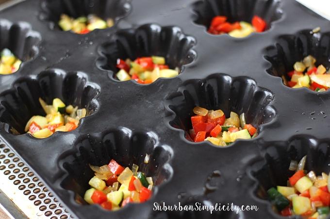 Veggies for quinoa frittatas in baking pan.