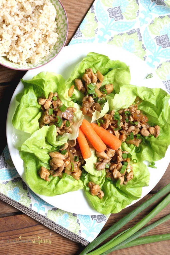 Chicken Lettuce Wraps plated with carrots