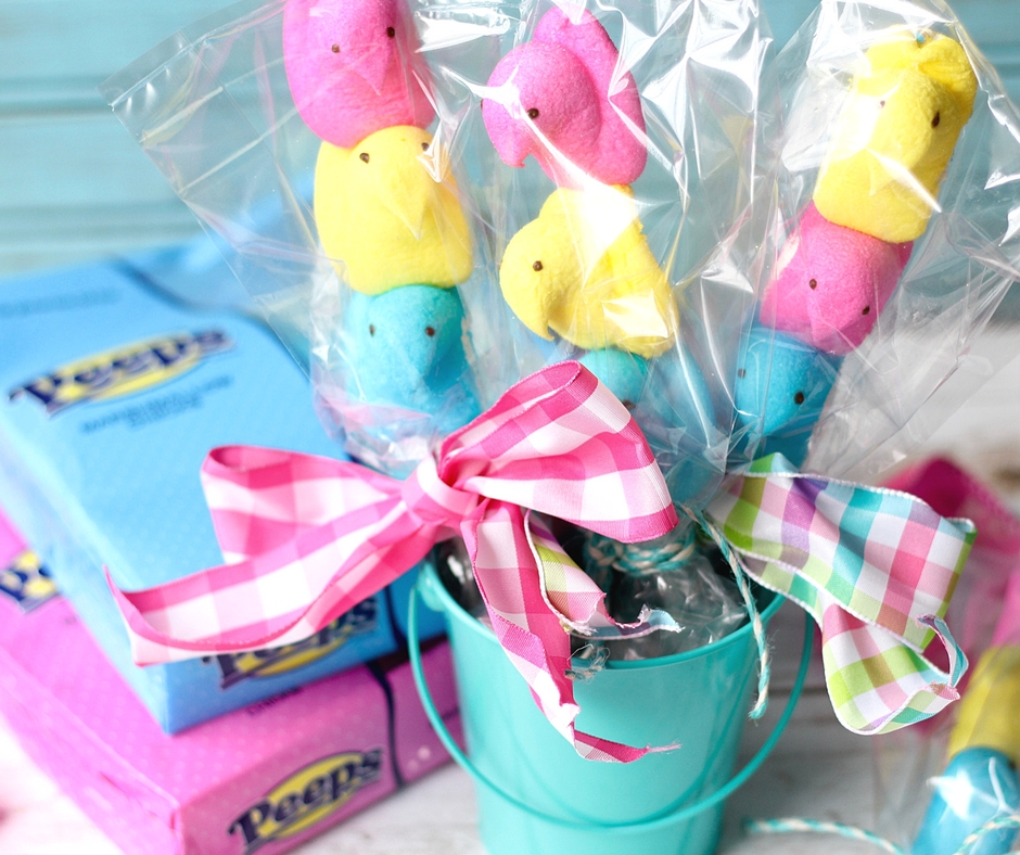 Easter Peeps on a Stick in a blue pail with pink ribbon.