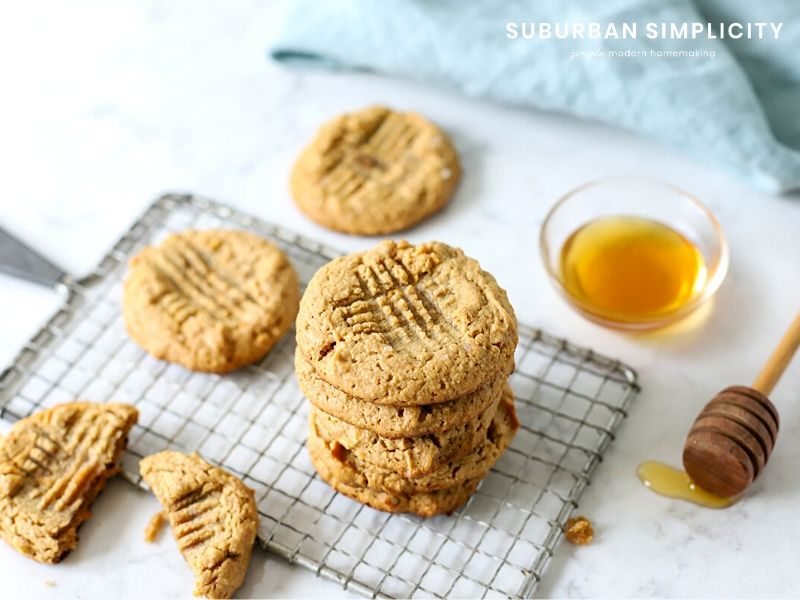 Flourless peanut butter cookies stacked on a cooling rack.