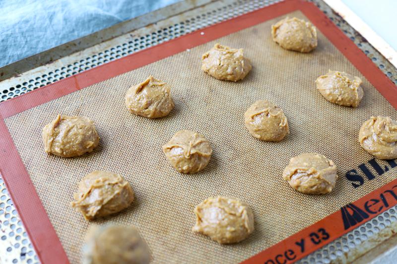 peanut butter cookie batter on a baking sheet