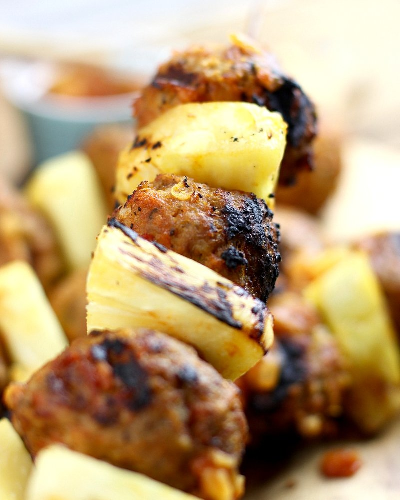 Close up of grilled pineapple meatball skewers ready to eat!