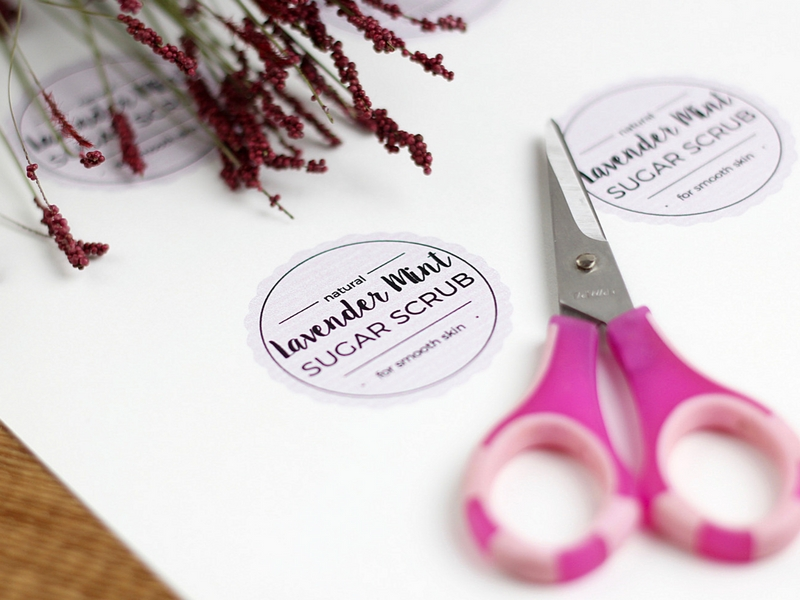 Printable tags saying lavender mint sugar scrub with a pair of scissors laying on top.