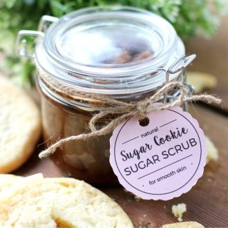 Sugar Cookie Sugar Scrub in a glass jar with a tag tied around it.