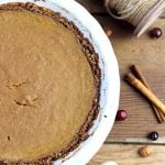 This Paleo Pumpkin Pie tastes delicious and is grain and dairy free.  This healthier Thanksgiving recipe has just the right amount of spice and a velvety filling you'll crave all season long!  #paleothanksgivingrecipe