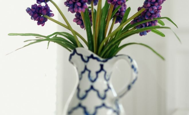 Purple flowers in a blue and white vase.