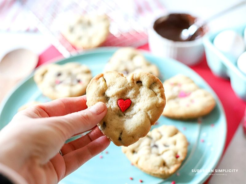 Hand holding Valentine's Day cookies