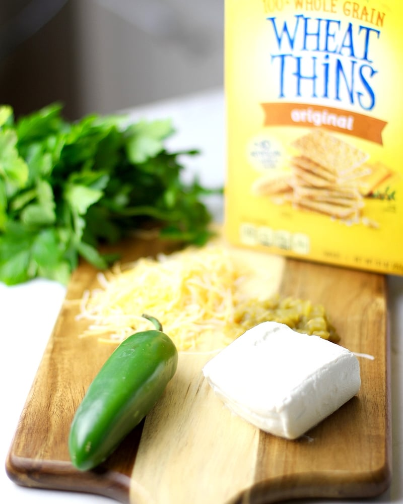 Cream cheese, cheese, peppers and Wheat Thins to make jalapeño crackers.
