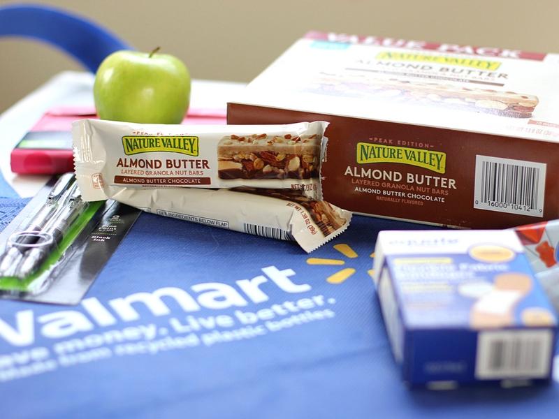 Walmart bag under granola bars and other mom essentials.