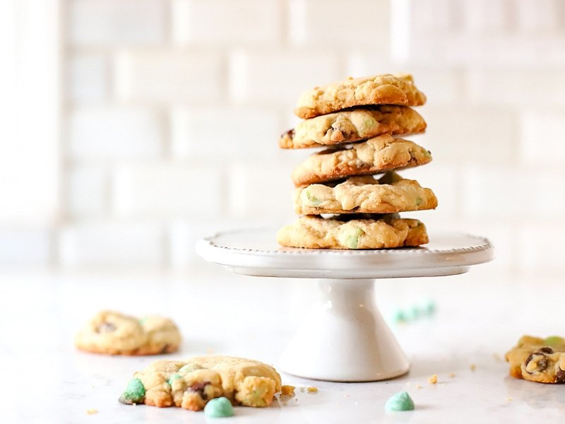 Mint Chocolate Chip Cookies on a cake stand.