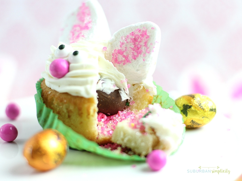 A bunny cupcake opened up to see the surprise inside.