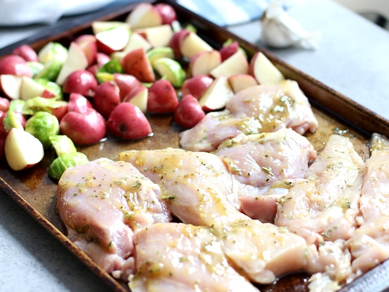 Vegetable and chicken in a pan ready to go in the oven.