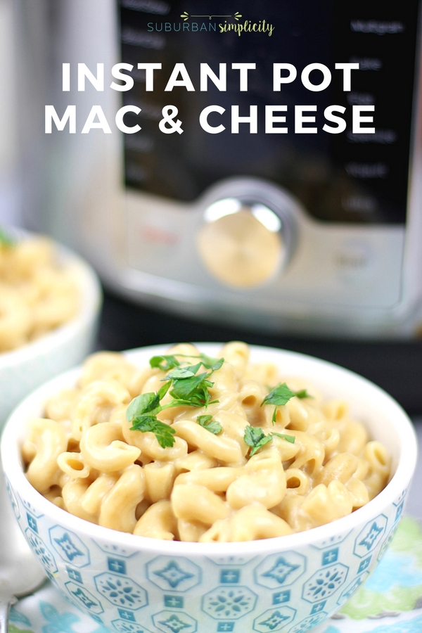 Bowl of mac and cheese in front of an instant pot machine.