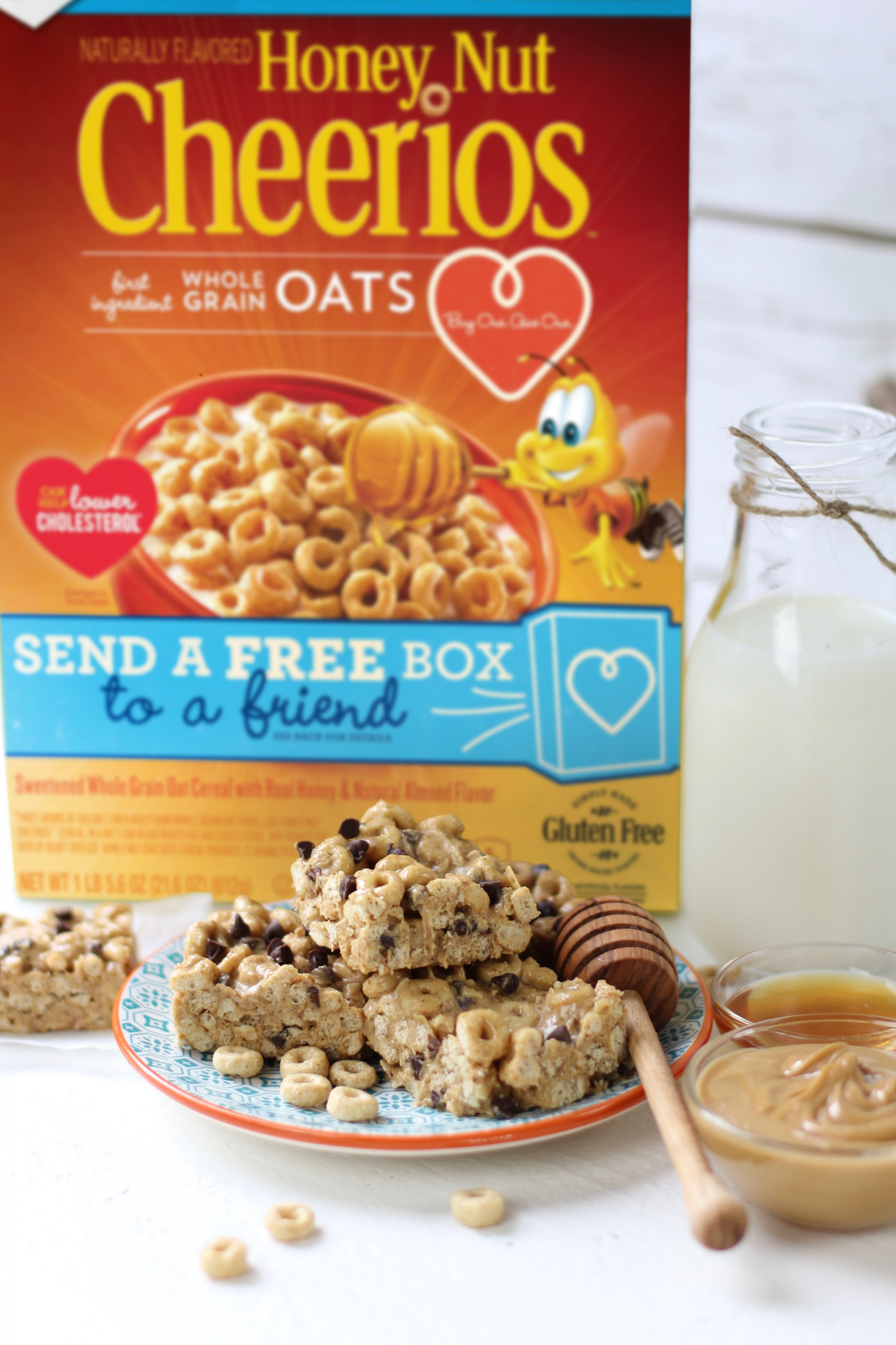Box on Honey Nut Cheerios with Protein Bites and milk in front of it