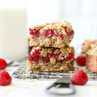 These Raspberry Oatmeal Bars are a must-try! You'll love the few simple ingredients that come together to make a delicious crust and crumble layered with fresh raspberries. With whole grains and minimal sugar, they're a healthier option for a grab-n-go breakfast or tasty snack!
