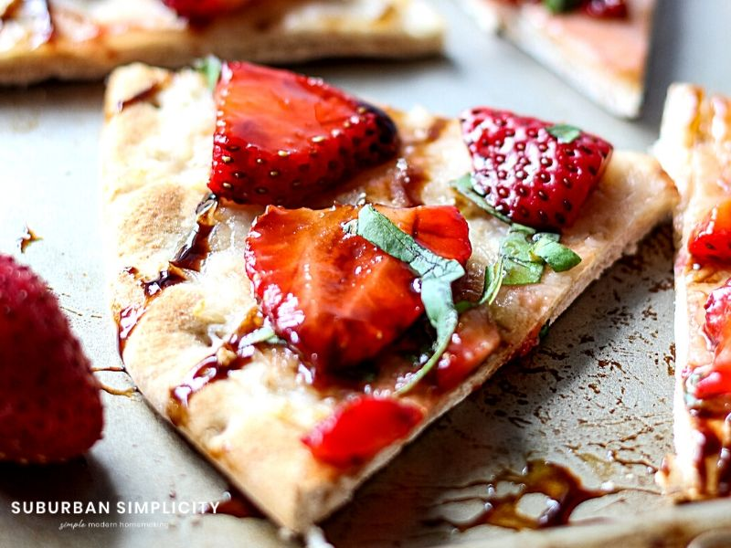 Strawberry Balsamic Flatbread is an easyrecipe with lots of sweet and savory flavors. Fresh strawberries and basil on top crispy baked flatbread. The perfect summer appetizer, snack or meal!
