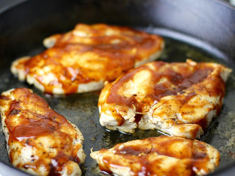 BBQ sauce smothered over chicken to make Monterey Chicken.