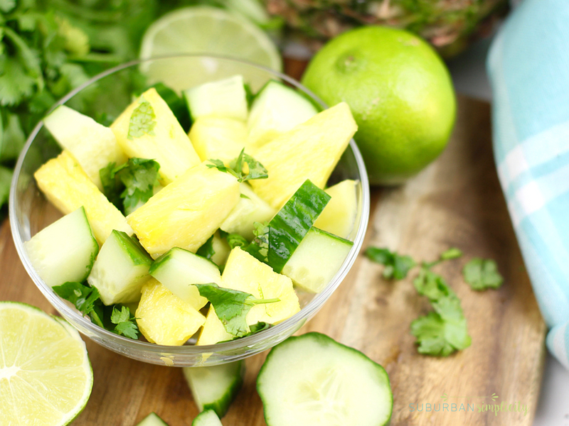 Pineapple cucumber salad in a bowl with fresh cilantro.