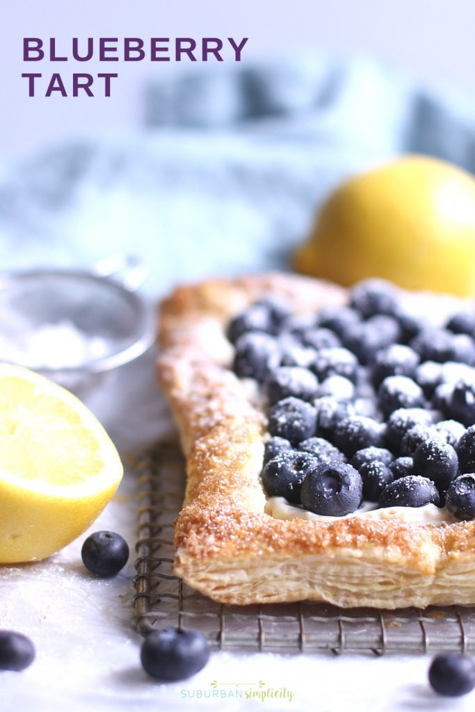 This Blueberry Cream Cheese Tart with Puff Pastry is so easy to make and so pretty to serve. Golden, flakey crust filled with creamy cheesecake filling, topped with fresh blueberries.