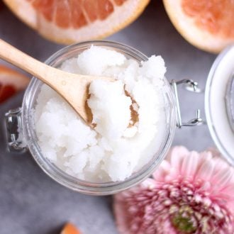 Grapefruit sugar scrub with a spoon on top.