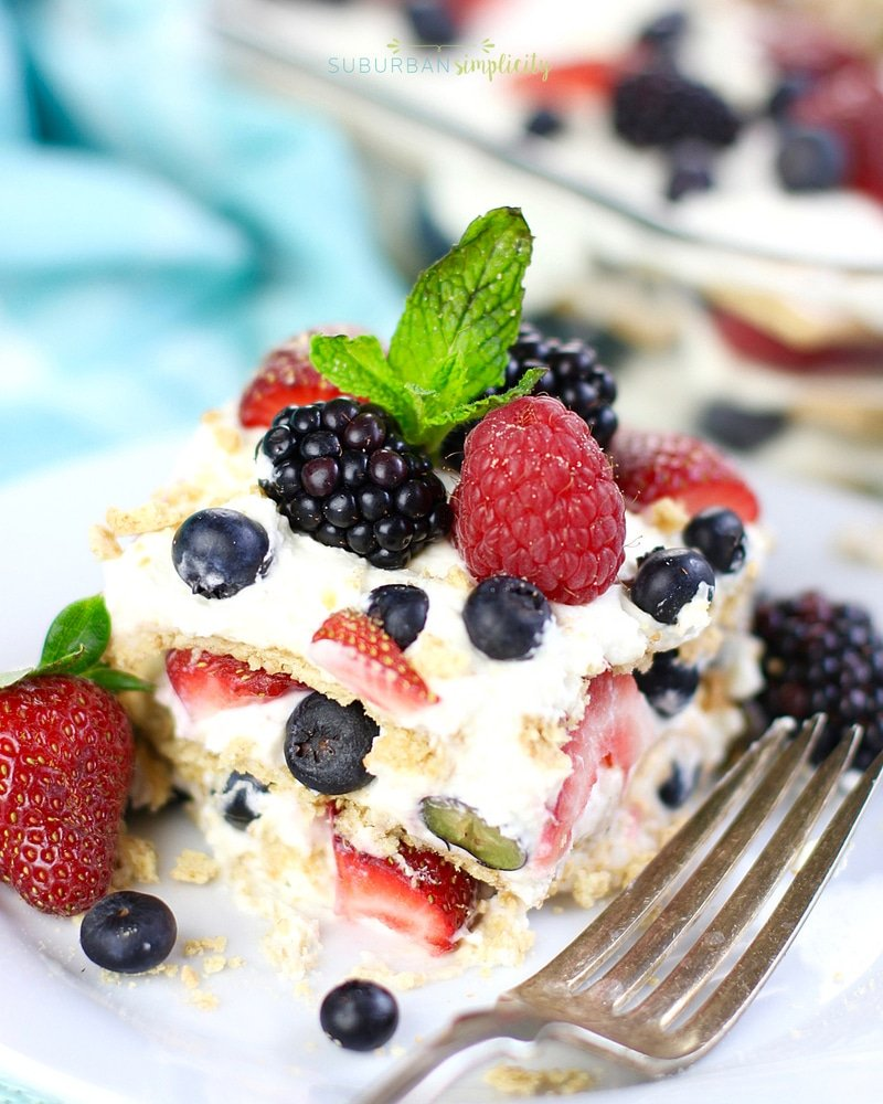 Easy Summer Berry Icebox Cake on a plate with a fork next to it.
