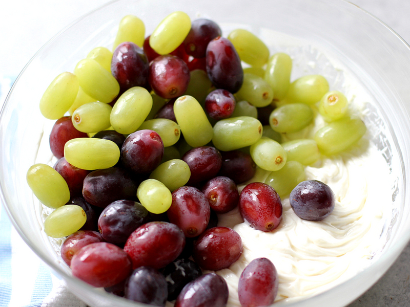 Grapes and creamy topping in a bowl.