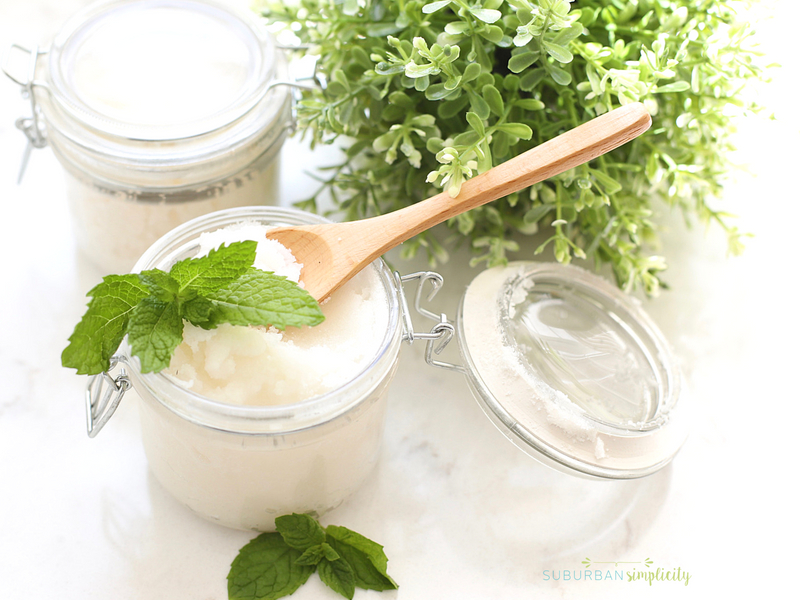 Mint sugar scrub with a wooden spoon on top.