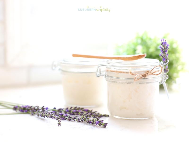 Lavender sugar scrub in jars with fresh lavender next to it.