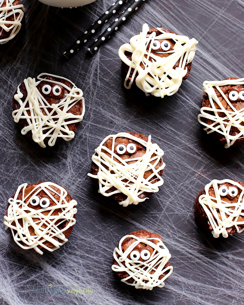 Brownie Mummies on spider web background.