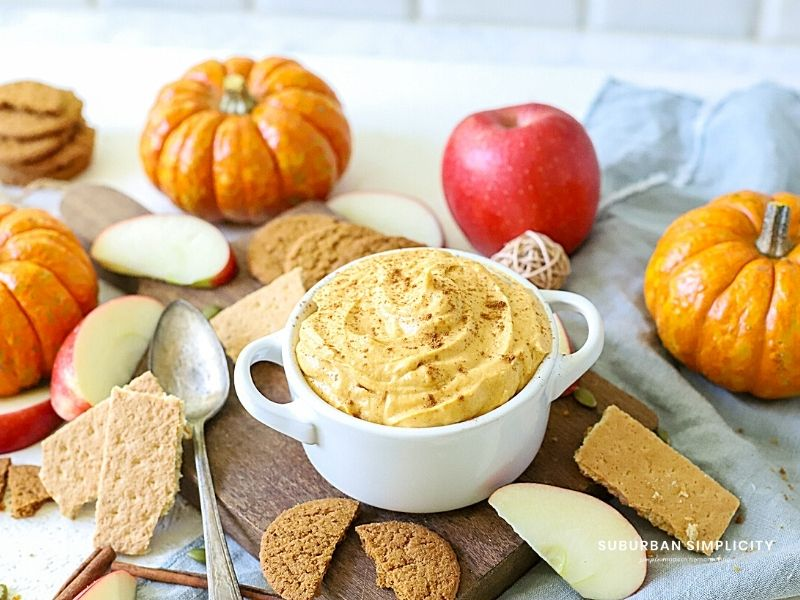 Fall dip with cream cheese in a bowl with apples and cookies