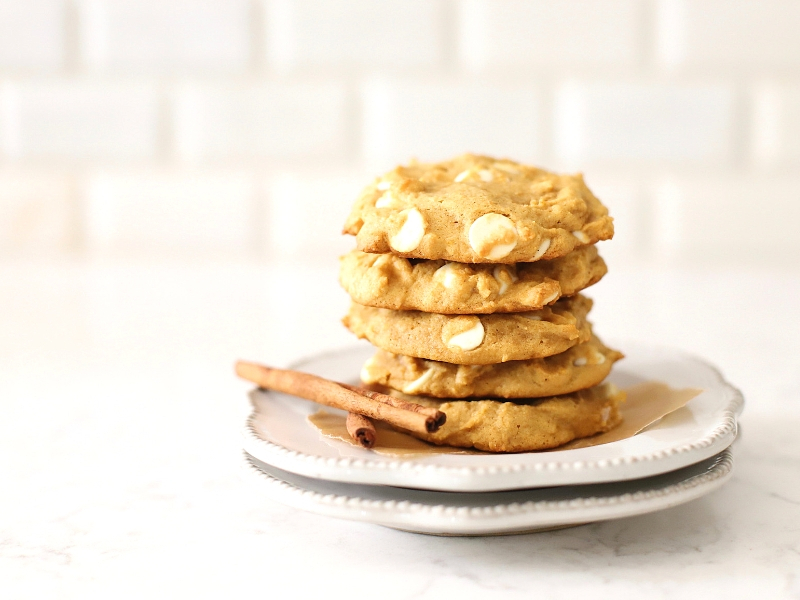 pumpkin spice cookies stacked on a plate.