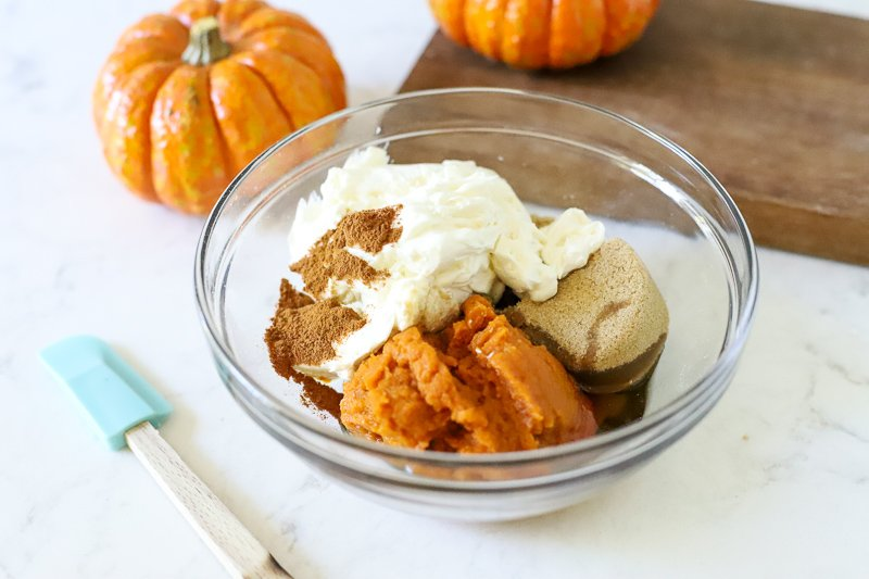 Ingredients for pumpkin spice dip in a bowl