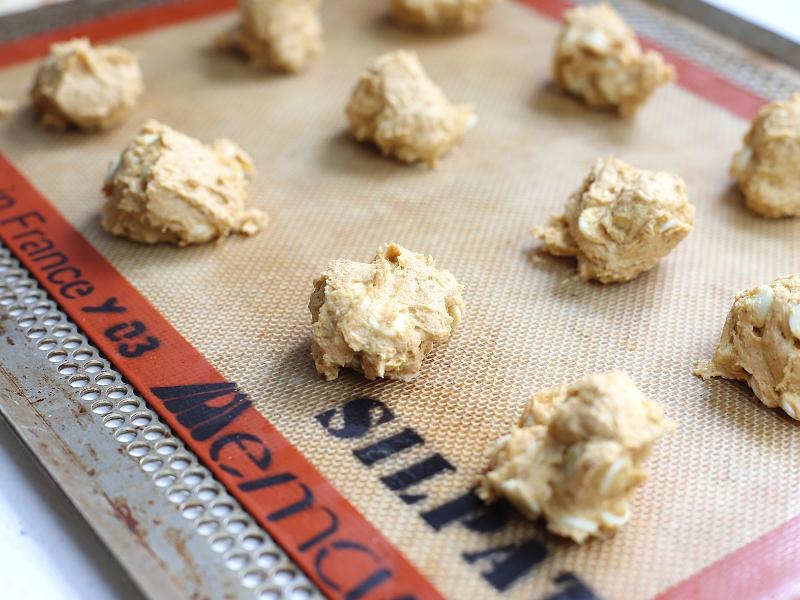 Pumpkin spice cookies on a baking sheet.