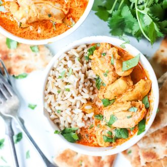 Instant Pot Butter Chicken in bowls with rice with forks laying next to them