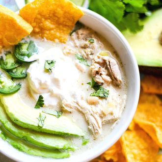 Crock Pot White Chicken Chili in a bowl with toppings