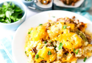 This easy Crock Pot Tater Tot Casserole is a must-make! Crispy tater tots, layered between ground beef, and smothered in cheese. Yum!