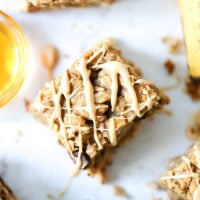 Oatmeal Banana Bars drizzled with white chocolate and peanut butter.