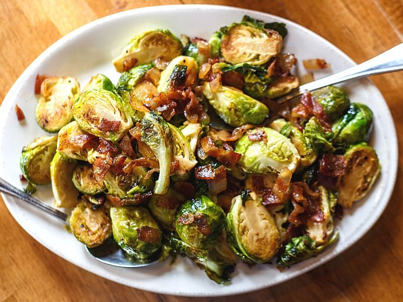 Brussel sprouts with bacon on a plate