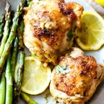 Instant Pot Lemon Chicken on a plate with roasted asparagus.