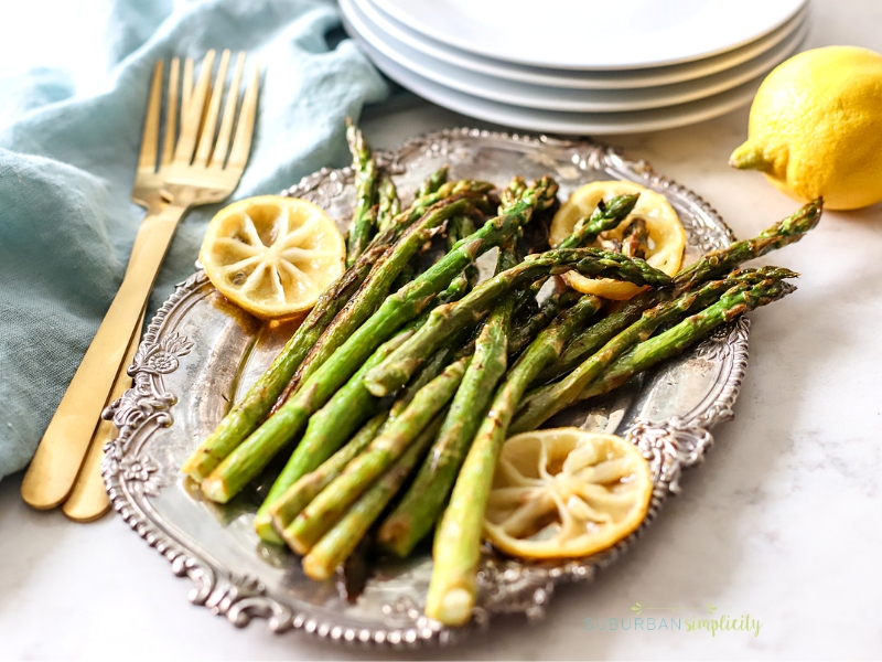 Roasted Asparagus with Lemon on a serving dish.