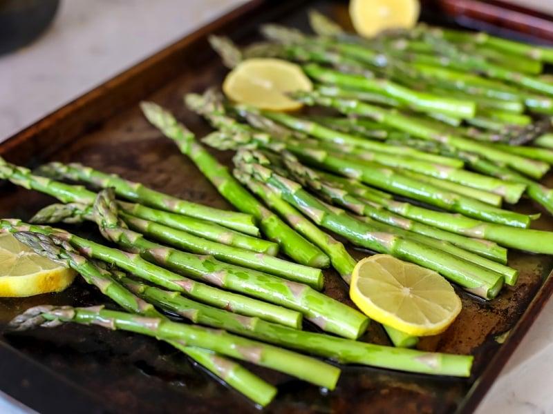 Roasting pan full of asparagus.