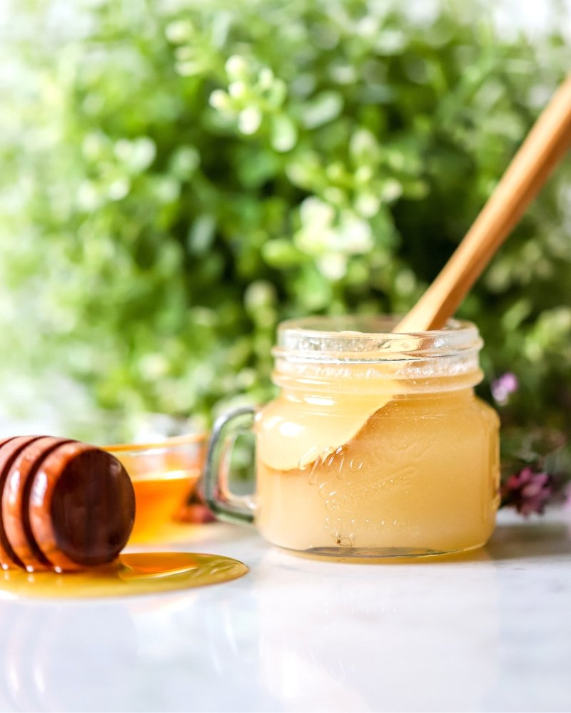 DIY Sugar and Honey Lip Scrub in glass jar.