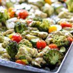 A healthy chicken pesto recipe on a baking pan