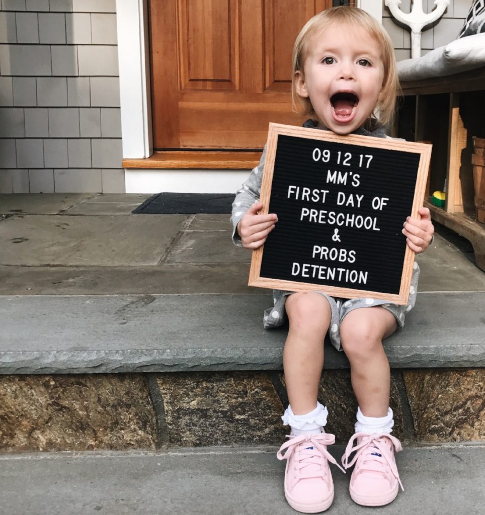 A young child holding a sign